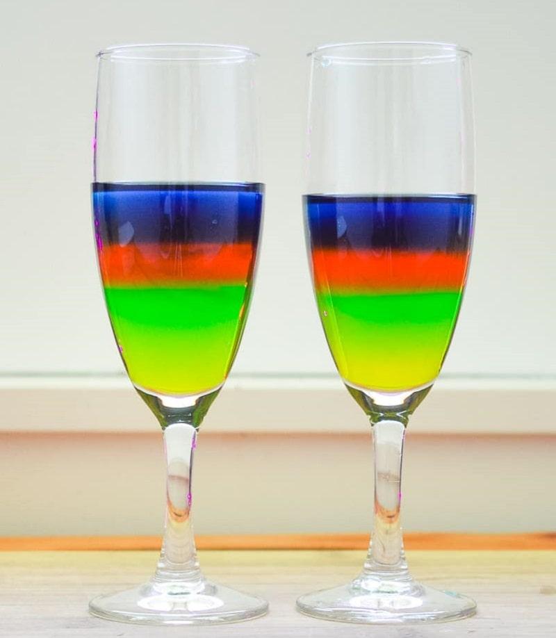 rainbow sugar water density experiment in wine glasses