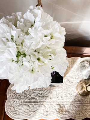 white flowers on nightstand