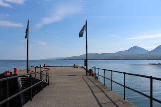 Looking along Bruichladdich pier with the Paps of Jura behind