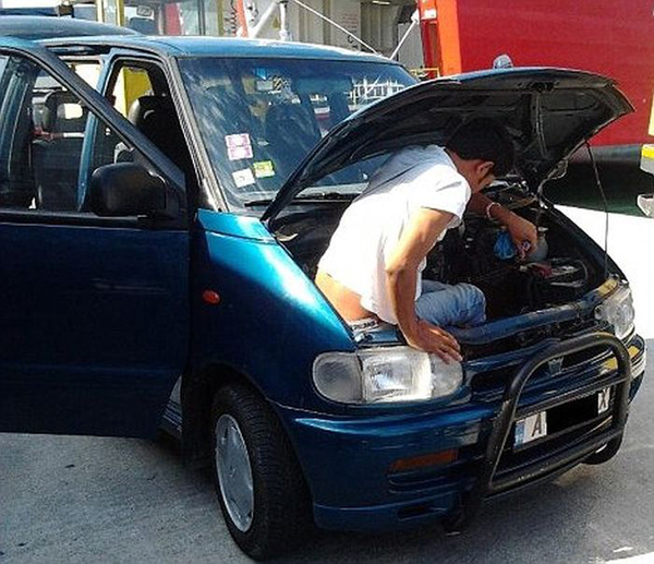 Pix Grove: Illegal Immigrant Caught Under The Hood Of A Car
