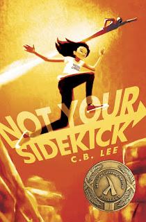 An Asian girl runs triumphantly through the air against an orange sky.
