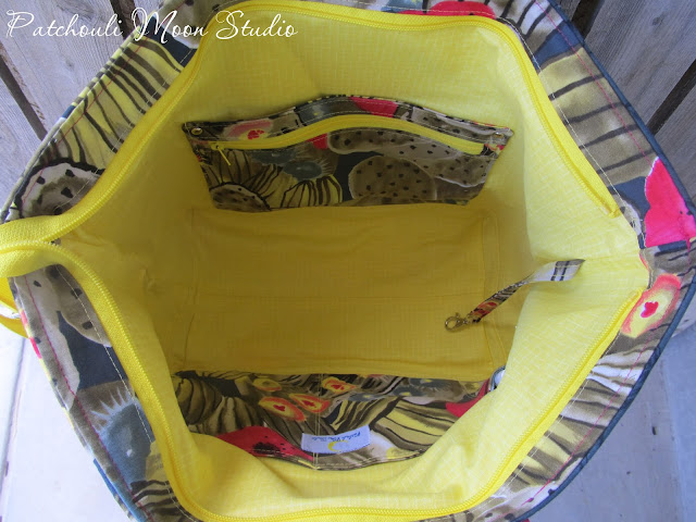 Inside view of Large tote bag has yellow lining and cactus print pockets