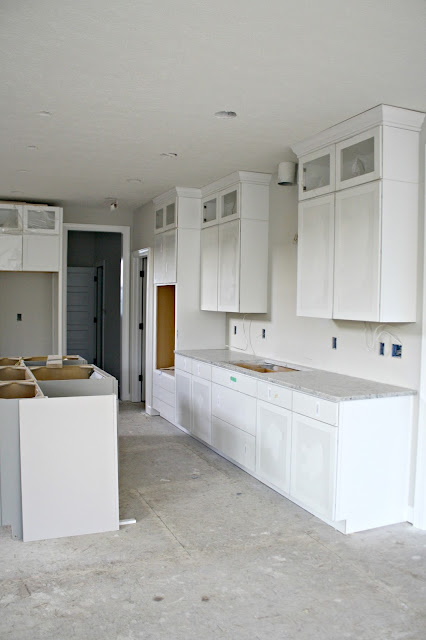 gray island white cabinets