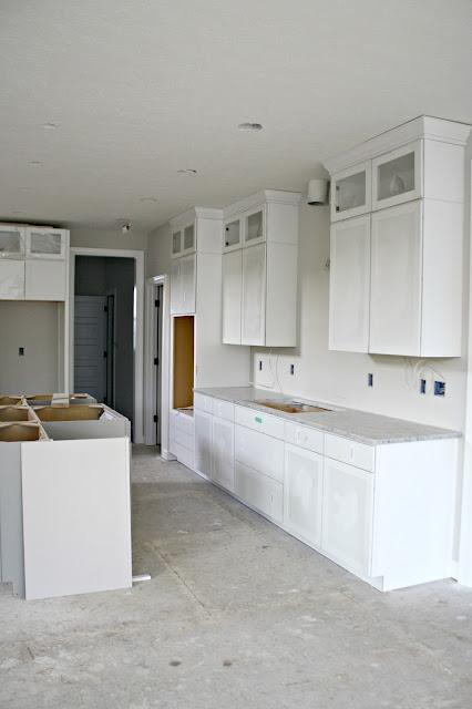 gray island white cabinets
