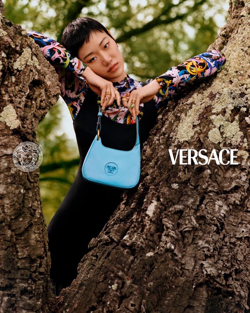 Sora Choi poses with La Medusa bag for Versace pre-fall 2021 campaign.