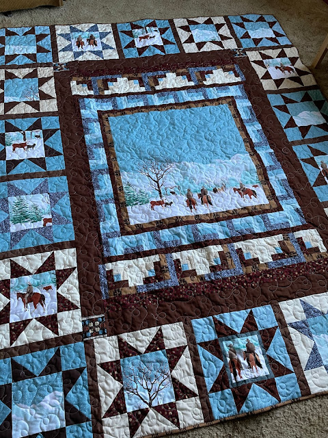 A larger look at the quilt, showing the 18 Variable star blocks around the center