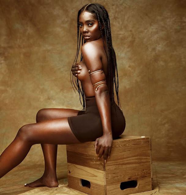 Tiwa Savage goes topless
