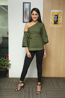 Pragya Jaiswal in a single Sleeves Off Shoulder Green Top Black Leggings promoting JJN Movie at Radio City 10.08.2017 052.JPG