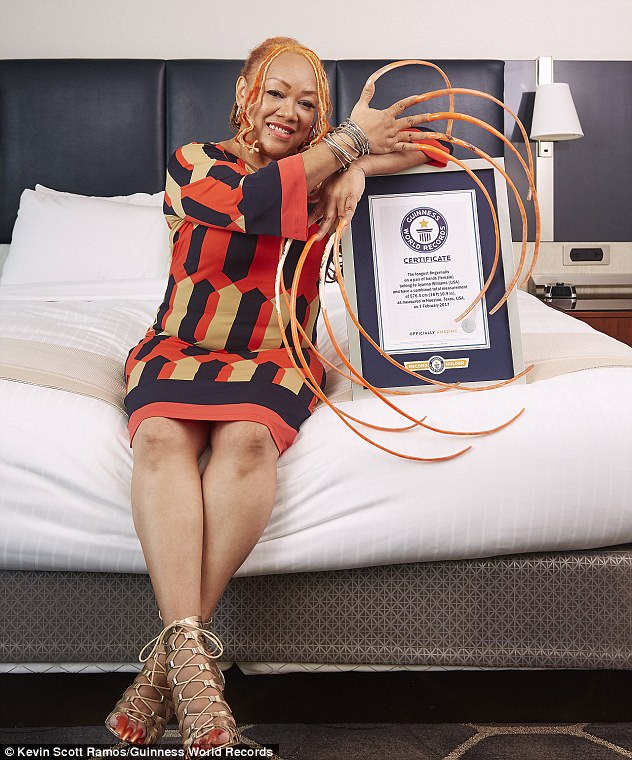 Woman spends at least 23 years growing the world's longest fingernails, now officially part of the Guinness World Records 2018 edition