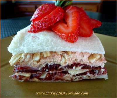 Peanut Butter Sandwich Stacks:Layers of bread, peanut butter mixtures, strawberries and more. The ultimate peanut butter and jelly sandwich. | Recipe developed by www.BakingInATornado.com | #recipe #lunch #sandwich