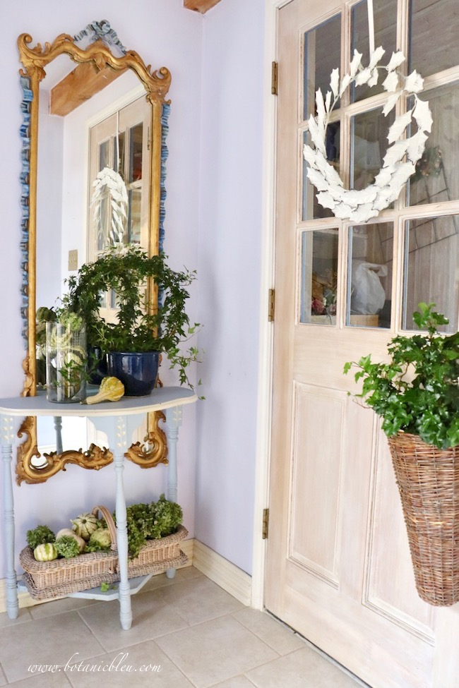 Small Fall Foyer decorated with green gourds, hydrangeas, ivy wreath for traditional styling