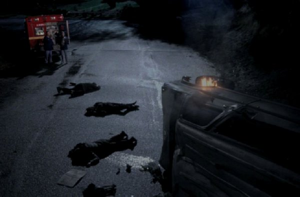 Grey's Anatomy - Grey's Anatomy - Nightime on street Karev and Meredith stand next to ambulance, 3 bodies lie on street