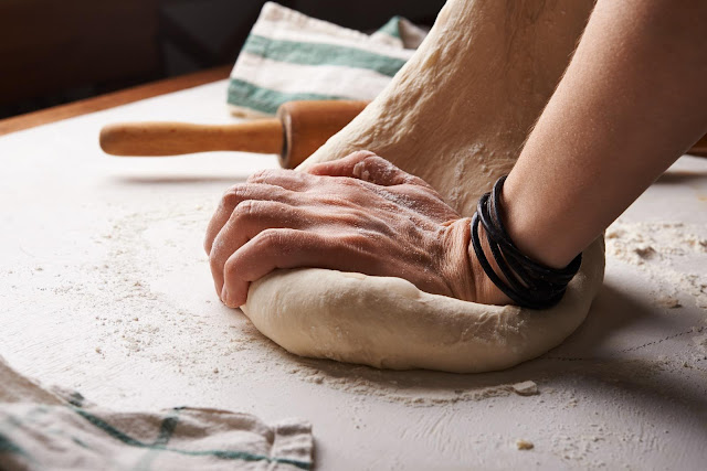 Dough and Hands | Photo by Nadya Spetnitskaya via Unsplash