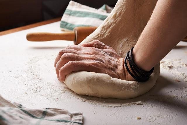 Dough and Hands | Photo by Nadya Spetnitskaya via Unsplash
