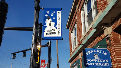 new seasonal banners up on the street lights in downtown Franklin