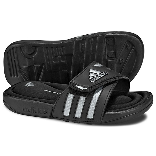 c9924cc3844fbc Kid-style comfort. These classic Adissage Fitfoam Slides by adidas have a  FITFOAM® footbed made of a soft material that custom molds to little feet  for cool ...