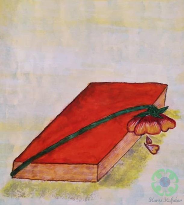 Kitap üzerinde solmuş bir çiçek.