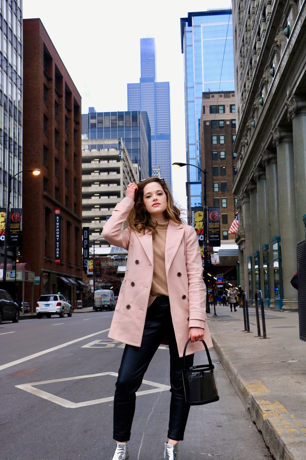 Nyc fashion blogger Kathleen Harper wearing a blush pink coat.