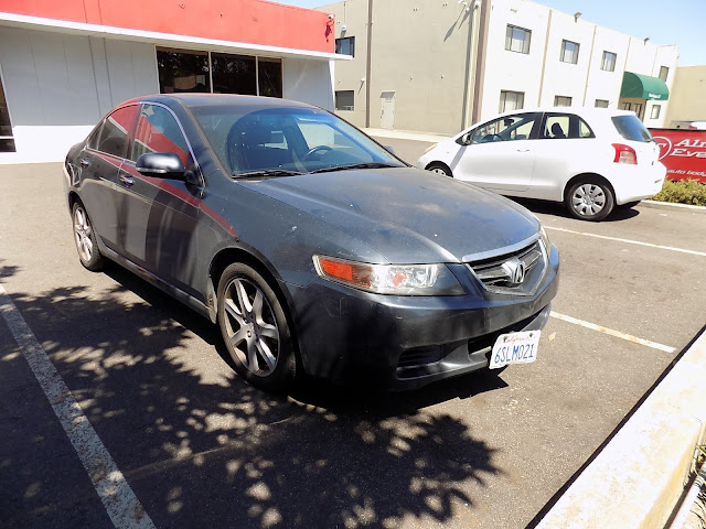 Faded Acura TSX before complete paint job at Almost Everything Auto Body.