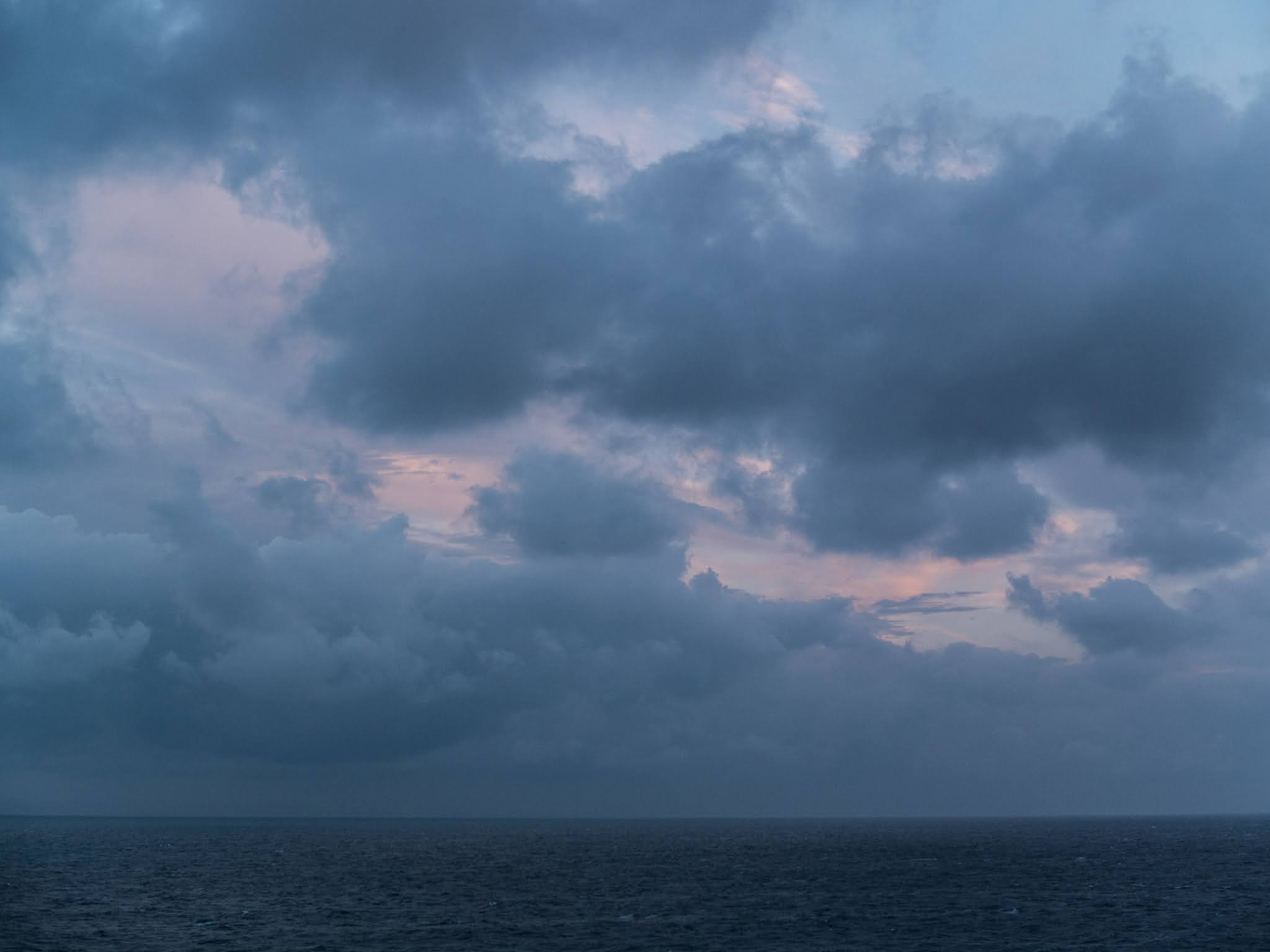 Clouds over the Mediterranean sea at twilight.