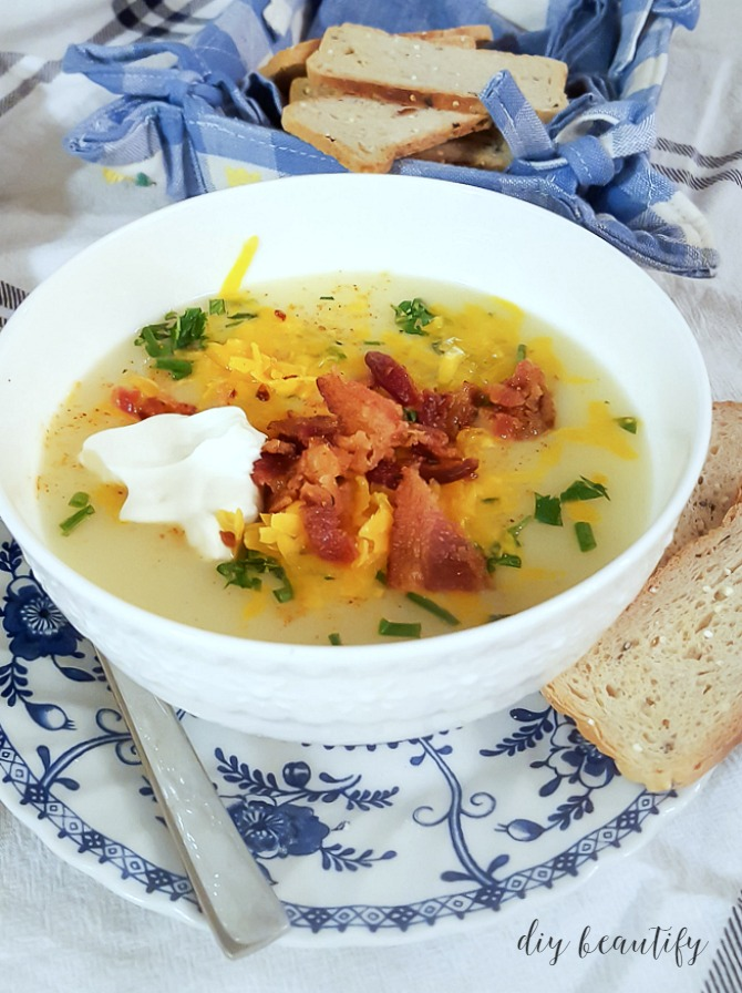 creamy potato soup with toppings and served with bread