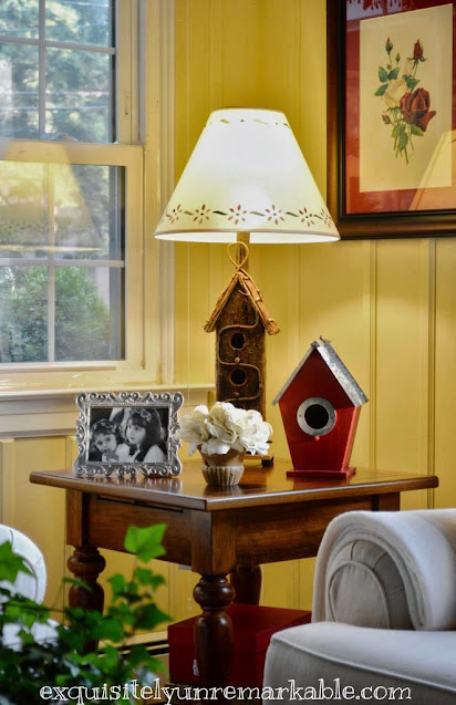 DIY Birdhouse Lamp on a table in a living room