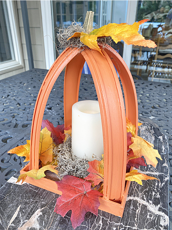 Pumpkin lantern with stem, leaves and battery candle