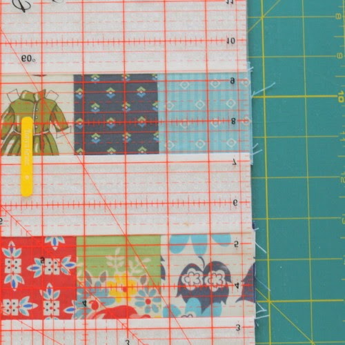 http://thecraftymummy.com/2014/06/square-up-quilt-block/