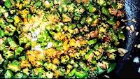 Chopped bhindi with spice powder on a pan for bhindi ki sabji bhindi fry recipe