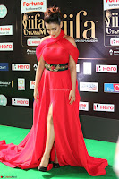 Apoorva in a Stunning Tight Leg Split Sleeveless Red Gown at IIFA Utsavam Awards 08.JPG