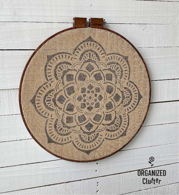 Photo of framed stenciled mandala on burlap