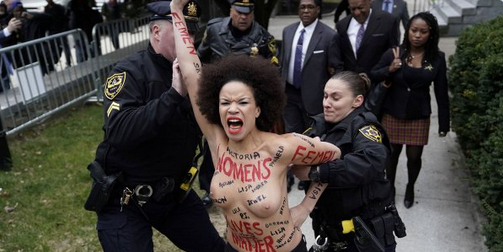 Actress-Nicolle-Rochelle-stages-Topless-Protest-at-Bill-Cosbys-Trial-1