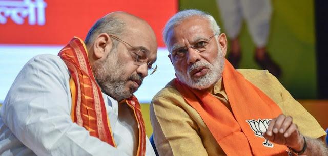 amit shah(left) and narendra modi(right)