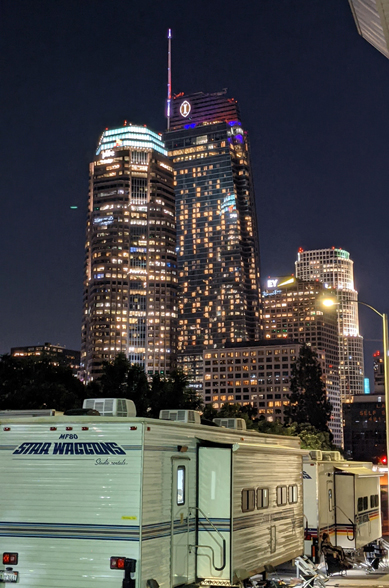 The Wilshire Grand Center and other skyscrapers tower over a group of honeywagons at Los Angeles Center Studios...on October 14, 2021.