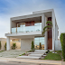 Fachada de casa contemporânea com pano de vidro reflecta em terreno 12x30 !