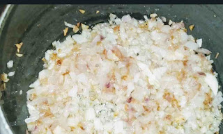 Frying chopped onion for mutton masala