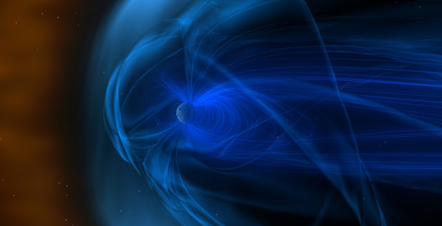 A giant magnetic field (swirling blue lines) surrounds Earth. As Earth travels through solar wind (orange area), its magnetic field creates a bow shock in front of itself (pale blue area). Image: NASA/Goddard Space Flight Center