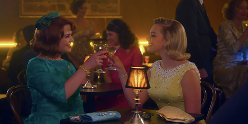 A scene from Why Women Kill. Ginnifer Goodwin and her husband's mistress are in a cocktail bar.
