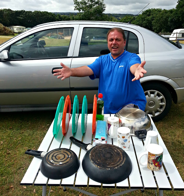 Man with Washing Up on Camp Table