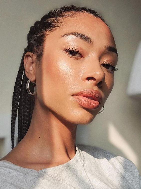 ASOS Lesley wearing nude lipstick and glowy makeup