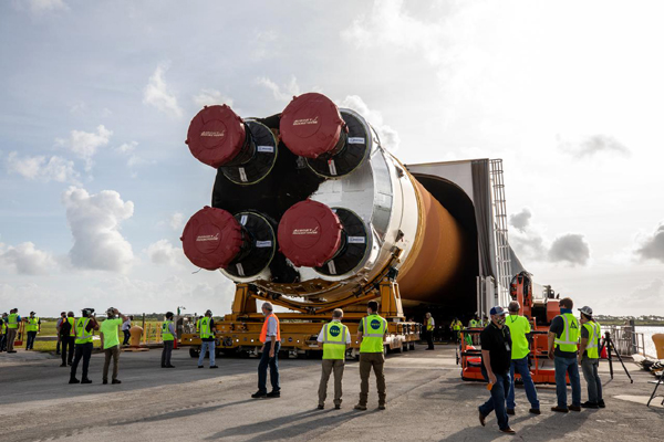 The SLS core stage booster for Artemis 1 is removed from the Pegasus barge prior to being transported to the Vehicle Assembly Building at NASA's Kennedy Space Center in Florida...on April 29, 2021.