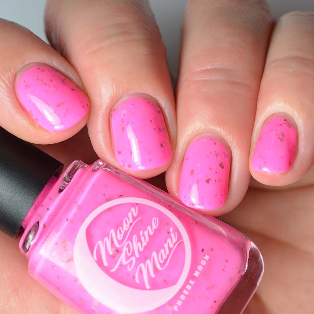 neon pink nail polish with color shifting flakies swatch