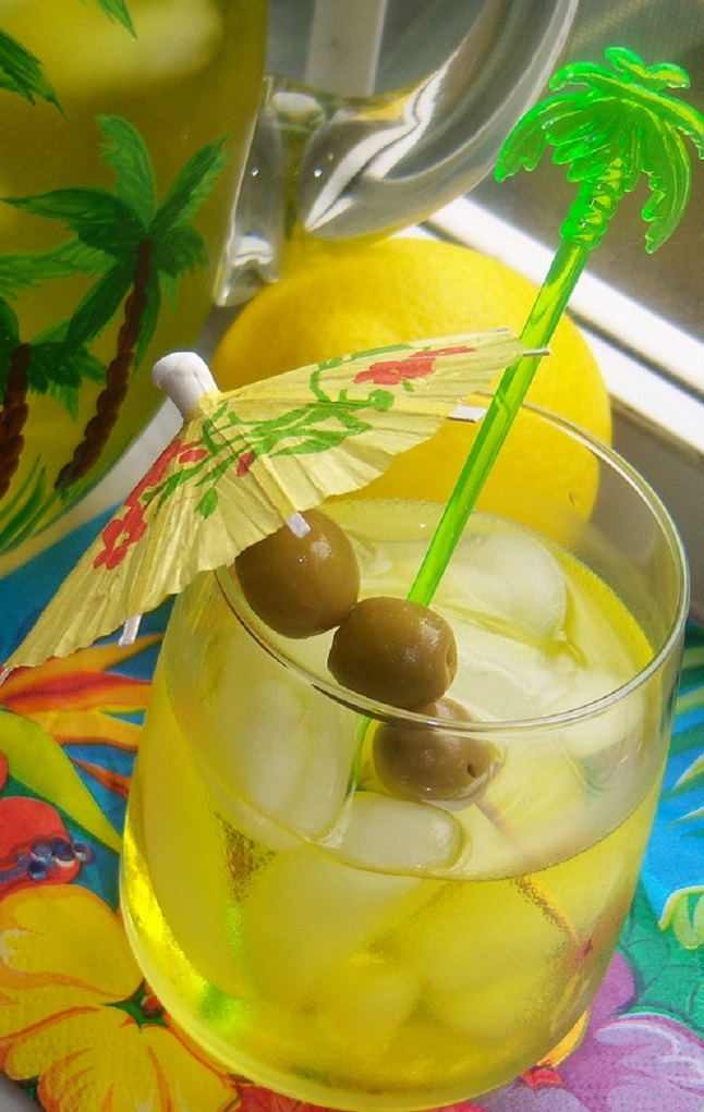 this is a limoncello cocktail with an umbrella and lemons in the background