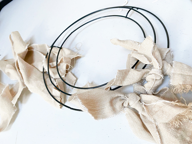 rags tied onto wire frame