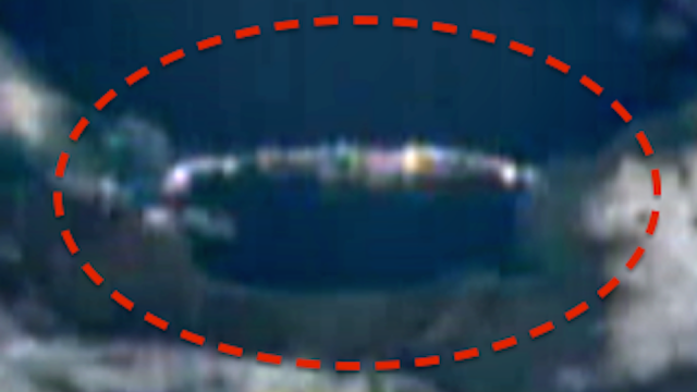 This is a mile long UFO spotted by a UFO researcher from the ISS live feed.