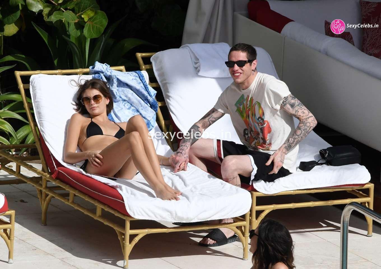 Kaia Gerber in tiny wet black bikini tongue kissing Pete Davidson in Miami Beach Pool