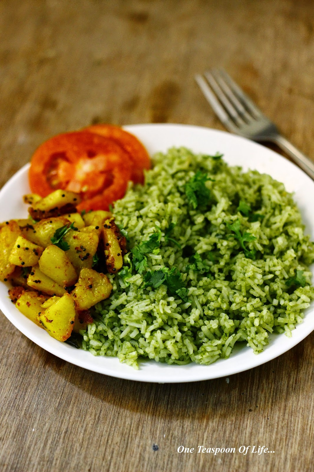 Mexican green rice with spicy fried potatoes