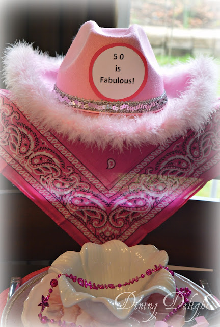 A Fuchsia Pink Its My Birthday Necklace Which I Draped Over Her Soup Bowl Until She Sat Down When We Made Put It The Hat And Kerchief On