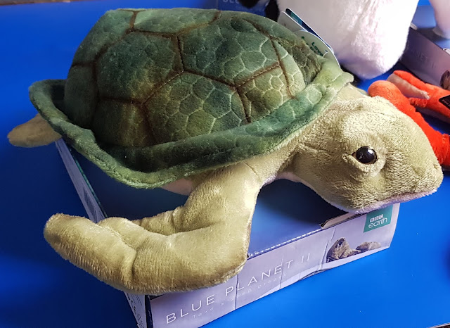 Posh Paws BBC Earth Soft Toy Sea Turtle in green on display plinth