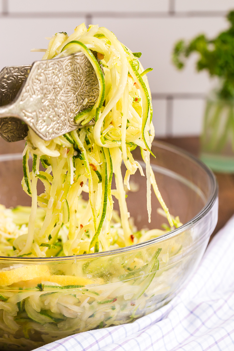 Lemon Garlic Zucchini Noodles - Fresh zucchini noodles tossed in a simple lemon garlic butter are the perfect easy to make low carb side dish! #zucchini #zoodles #lowcarb #keto #pasta #lemon #garlic #sidedish #easy #recipe | bobbiskozykitchen.com